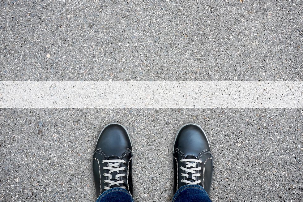 Black casual shoes standing at the white line